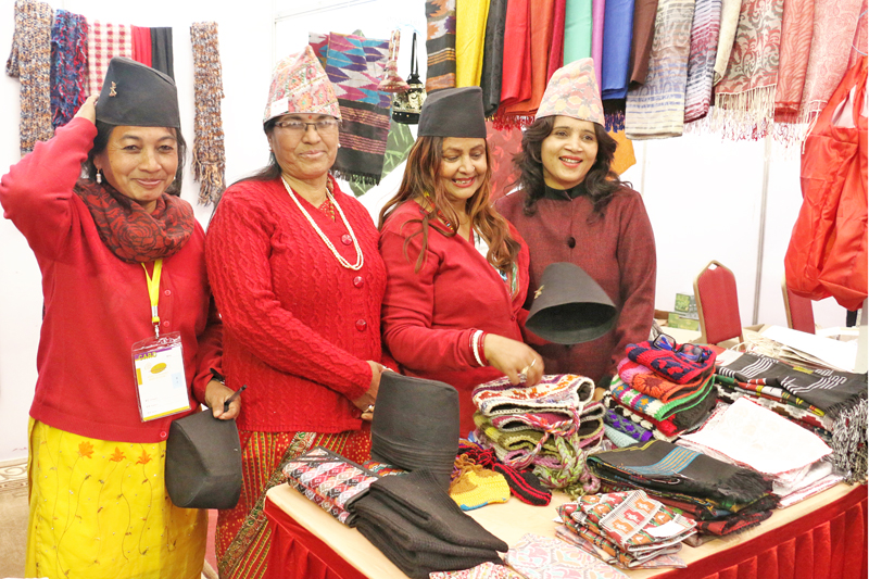 Women wear traditional dhaka topis as they sell handicraft products during the Nepal Expo at Bhrikutimandap on Thursday, January 7, 2016. Photo: RSS
