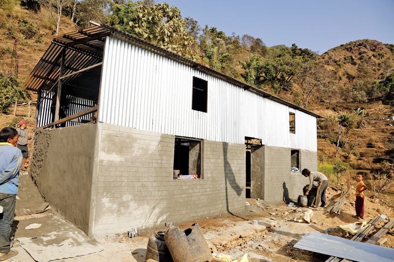 Quake survivors building earhquake resistant house in their own expenses in Batase, Sindhulpalchok district on Wednesday, January 27, 2016. Photo: RSS