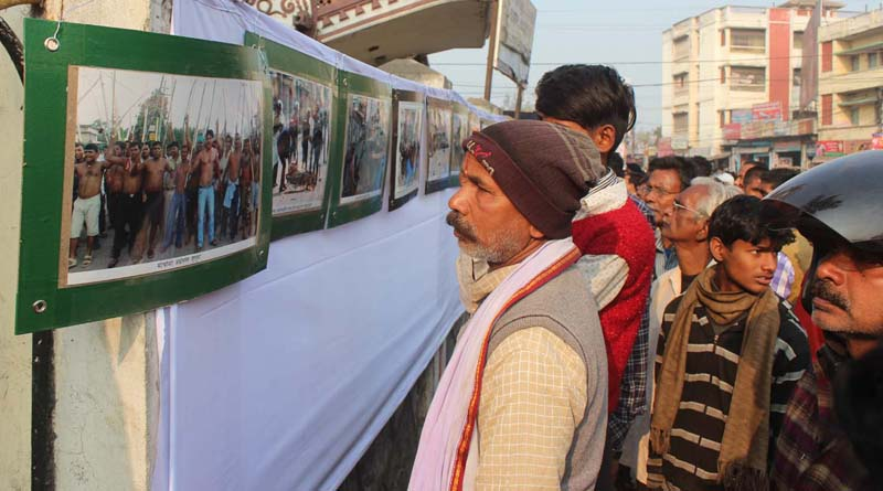 Locals look at photographs exhibited by The Himalayan Times Birgunj correspondent Ram Sarraf in Birgunj of Parsa district on Friday, January 15, 2015. Sarraf has included his 60 photos about the ongoing Tarai agitation in the exhibition. Photo: THT Online