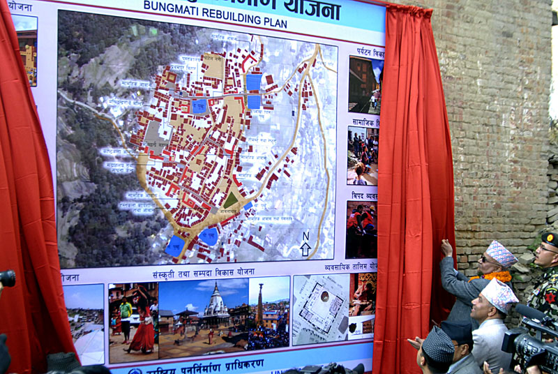 Prime Minister KP Sharma Oli unveiling the masterplan for reconstruction of Bungamati Village on the occasion of 18th National Earthquake Safety Day and the official launch of reconstruction efforts, in Bungamati, Lalitpur, on Saturday. Photo: THT
