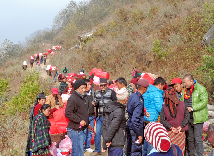 Snowfall and quake survivors returning to their temporary shelters after receiving warm clothes distributed by a Pokhara-based NGO, Asal Chhimeki, in Barpak of Gorkha, on Monday, January 18, 2016. Photo: RSS