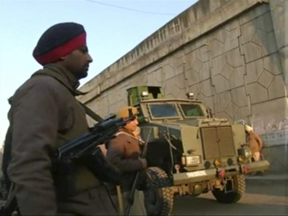 Police personnel stand guard following what officials said was an attack on an Indian Air Force base in Pathankot on Saturday near the border with Pakistan, in Pathankot, Punjab state, India, in this still frame taken from video, January 2, 2016. Photo: Reuters