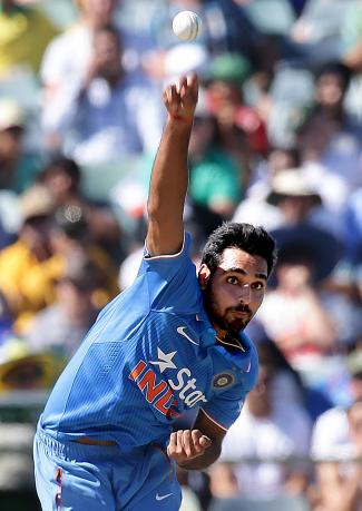 Bhuvneshwar Kumar bowls during their One Day International cricket match against Australia in Perth January 12, 2016.  Photo: Reuters