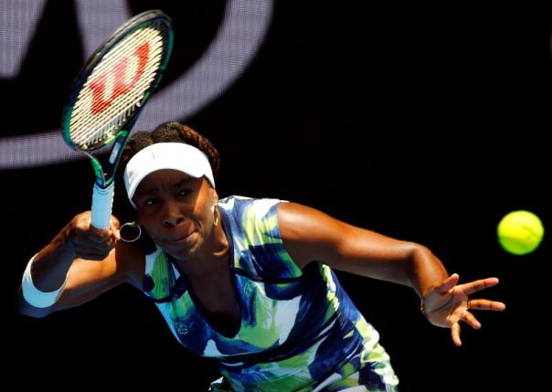 Venus Williams of the US hits a shot during her first round match against Britain's Johanna Konta at the Australian Open tennis tournament at Melbourne Park, Australia, January 19, 2016. Photo: Reuters