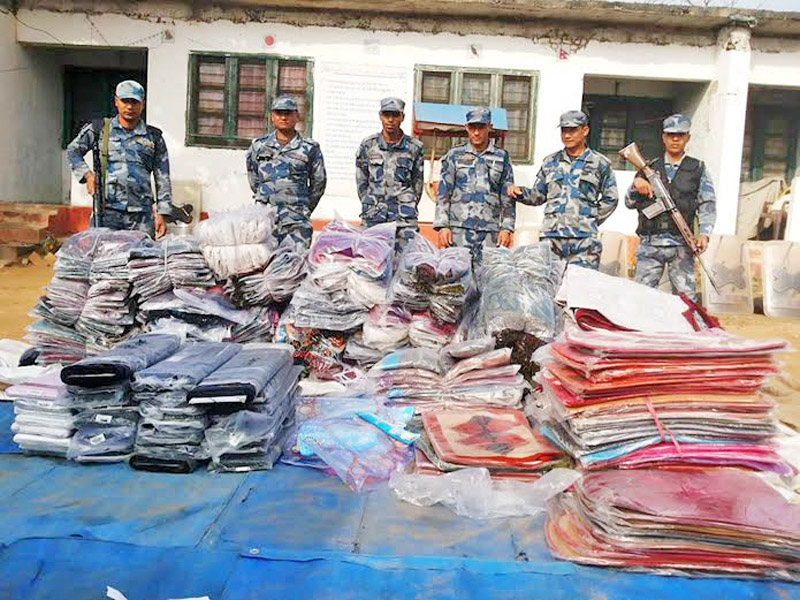 Police show clothes seized for customs evasion, on the premises of Gaur Border Out-Post Office in Rautahat district on Sunday, January 24, 2016. Photo: Prabhat Kumar Jha