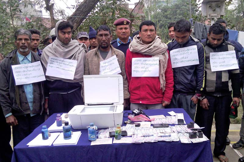 Police parading six persons arrested for printing fake Nepali notes from different places of Rautahat district on Thursday, January 21, 2016. Photo: Prabhat Kumar Jha/ THT
