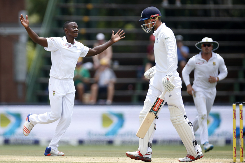 South Africa's Kagiso Rabada (L) celebrates the dismissal of England's Alex Hales after he was caught out by AB de Villiers during the third cricket test match in Johannesburg, South Africa, January 15, 2016. Photo: Reuters