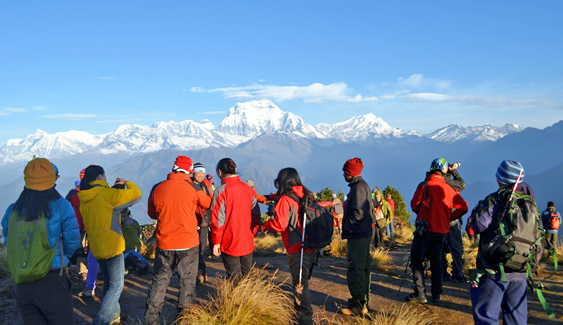 Tourists capture the panaromic view of a Himalayan range from Poon Hill in Ghorepani of Myagdi district on Monday, January 25, 2016. Photo: RSS