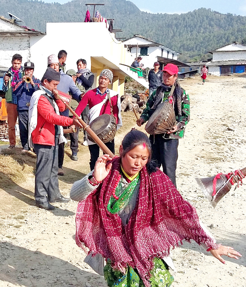 Locals welcoming a team that was heading towards Punhill through Nagi to explore a trekking route with musical instruments, in Kushma,  Parbat, on Monday, January 11, 2016. Photo: Rup Narayan Dhakal