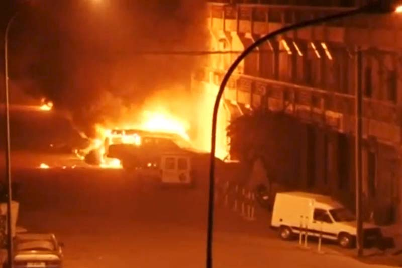 A view shows vehicles on fire outside Splendid Hotel in Ouagadougou, Burkina Faso in this still image taken from a video January 15, 2016, during a siege by Islamist gunmen. Photo: Reuters