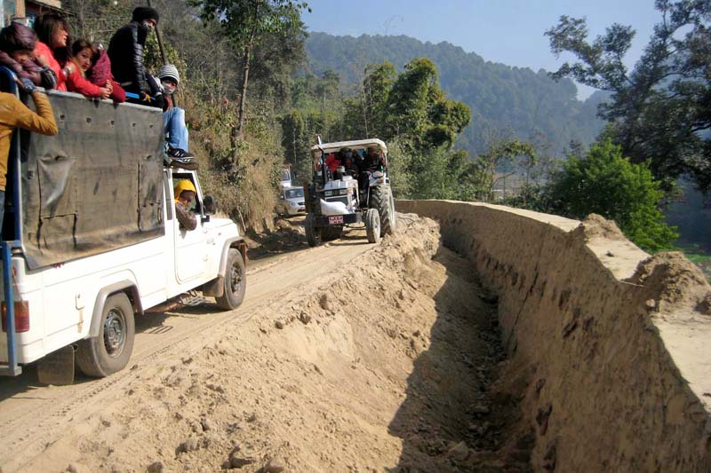 Vehicles passing along the Kamalbinayak-Nagarkot road, being upgraded by the Road Improvement Committee under the Department of Road, in Bhaktapur on Saturday, January 3, 2016. Photo: RSS