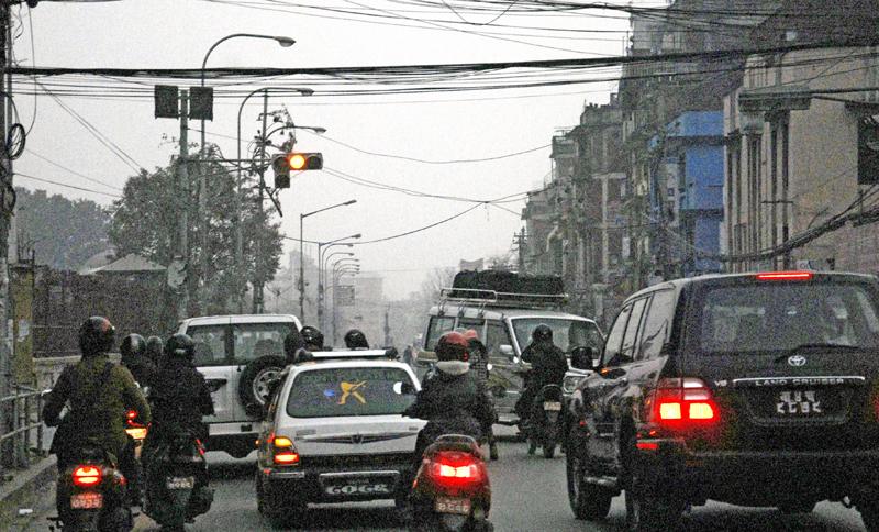 Vehicles seen plying a street shrouded with smog in kathmandu on Sunday, January 10, 2016. Photo: THT