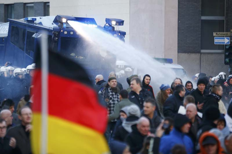 Police use a water cannon during a protest march by supporters of anti-immigration right-wing PEGIDA movement in Cologne, Germany, on January 9, 2016. Photo: Reuters
