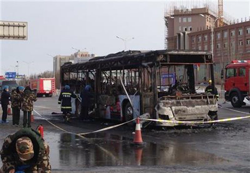 In this photo provided by China's Xinhua News Agency, firefighters work at an accident site of a bus fire in Yinchuan, the capital of Ningxia region, Tuesday, Jan. 5, 2016. Photo: AP