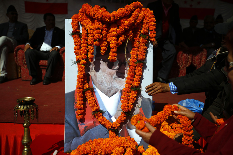 People offer garlands on the picture of late former Prime Minister Sushil Koirala during a condolence meeting organised in memory of former Prime Minister Sushil Koirala at Shantibatika, Ratnapark, Kathmandu on Sunday, February 21, 2016. Photo: Skanda Gautam