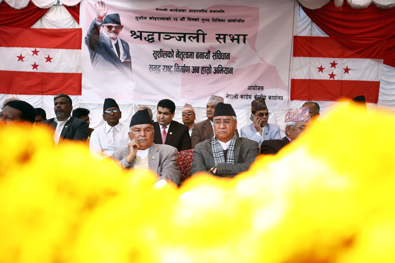 Nepali Congress acting President Ram Chandra Paudel (left) and senior leader Sher Bahadur Deuba are seen during a condolence meeting organised in memory of former Prime Minister Sushil Koirala at Shantibatika, Ratnapark, Kathmandu on Sunday, February 21, 2016. Photo: Skanda Gautam