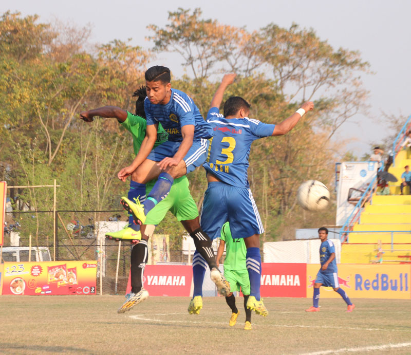 Players of Rupandehi-XI and Dharan Football Club (right) in action during their 18th International Invitational Budha Subba Red Bull Gold Cup Football Tournament in Dharan on Sunday. Photo: THT