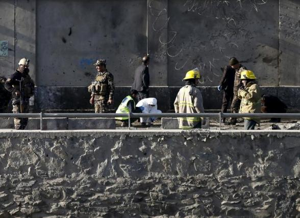 Afghan security forces inspect at the site of a suicide attack in Kabul, Afghanistan February 27, 2016. REUTERS/Mohammad Ismail