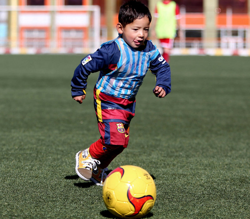 Murtaza Ahmadi, a five-year-old Afghan Lionel Messi fan, plays football at the Afghan Football Federation Stadium in Kabul, Afghanistan, Tuesday, February 2, 2016. Photo: AP