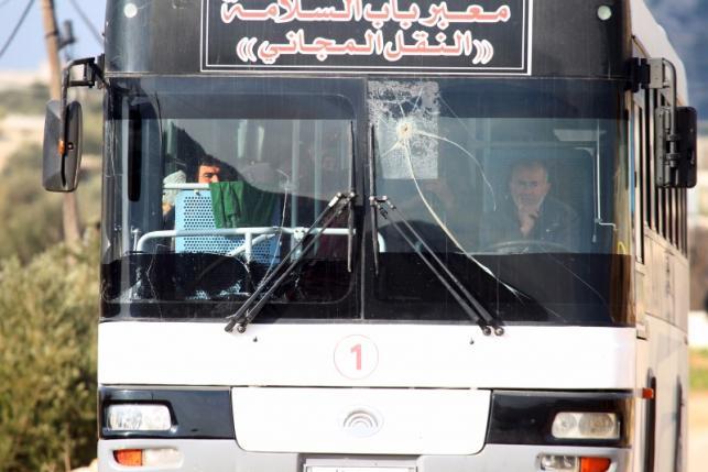 Syrians ride a bus towards Turkey to the Bab Al-Salam border crossing, in Darat Izza, Aleppo countryside, Syria February 10, 2016. REUTERS/Ammar Abdullah
