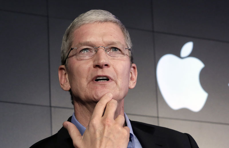 FILE - Apple CEO Tim Cook responds to a question during a news conference at IBM Watson headquarters, in New York, on April 30, 2015. Photo: AP