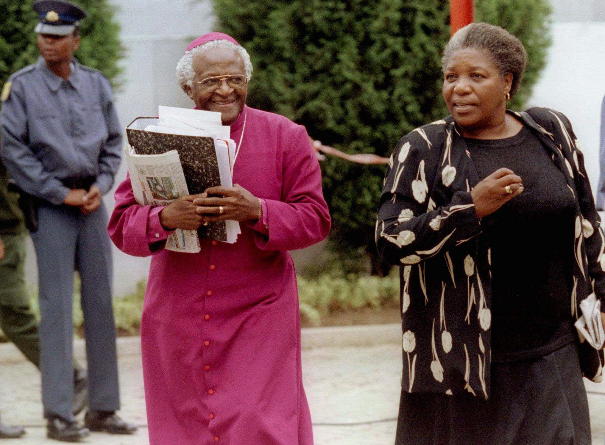 FILE - Archbishop Desmond Tutu and his wife Leah arrive at the special public hearing of South Africa's Truth and Reconciliation Commission in Johannesburg, on Thursday, November 27, 1997. Photo: AP
