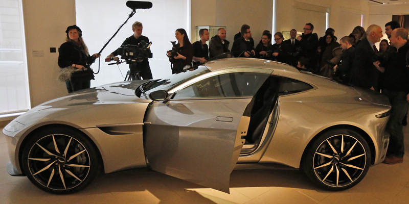 The James Bond Aston Martin of the latest Spectre movie is surrounded by people at the auction house Christie's in London, Monday, February 15, 2016. Photo: AP