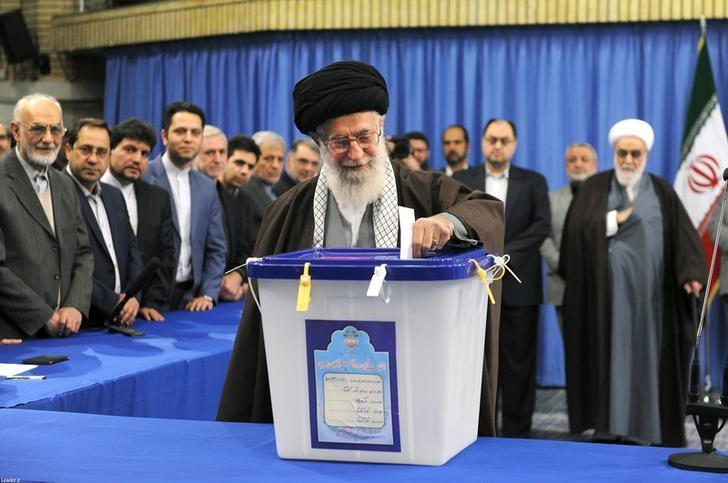 Iran's Supreme Leader Ayatollah Ali Khamenei casts his vote during elections for the parliament and Assembly of Experts, which has the power to appoint and dismiss the supreme leader, in Tehran February 26, 2016. REUTERS/leader.ir/Handout via Reuters