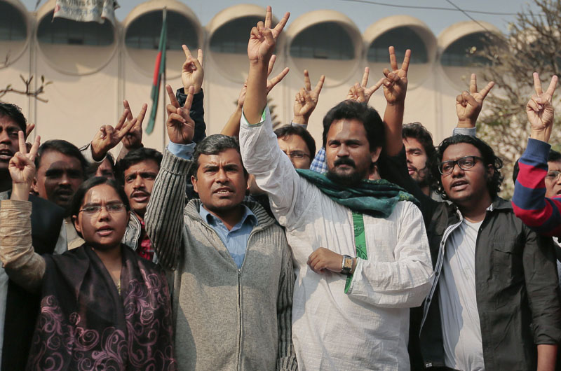Bangladeshi activists campaigning for capital punishment for war criminals celebrate outside the Supreme Court after a review petition of Jamaat-e-Islami party's senior leader Motiur Rahman Nizami's appeal against his death sentence was dismissed in Dhaka, Bangladesh, on Wednesday, January 6, 2016. Photo: AP