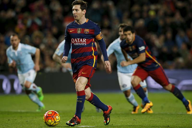 Barcelona's Lionel Messi takes a penalty to assist Luis Suarez to score a goal against Celta Vigo in the Spanish Liga BBVA at the Camp Nou stadium in Barcelona on February 14, 2016. Photo: Reuters