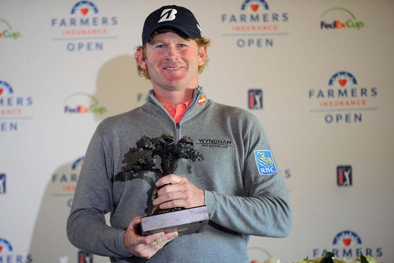 Brandt Snedeker of the USA holds the trophy after winning the Farmers Insurance Open at Torrey Pines on Monday. Photo: USA Today via AFP