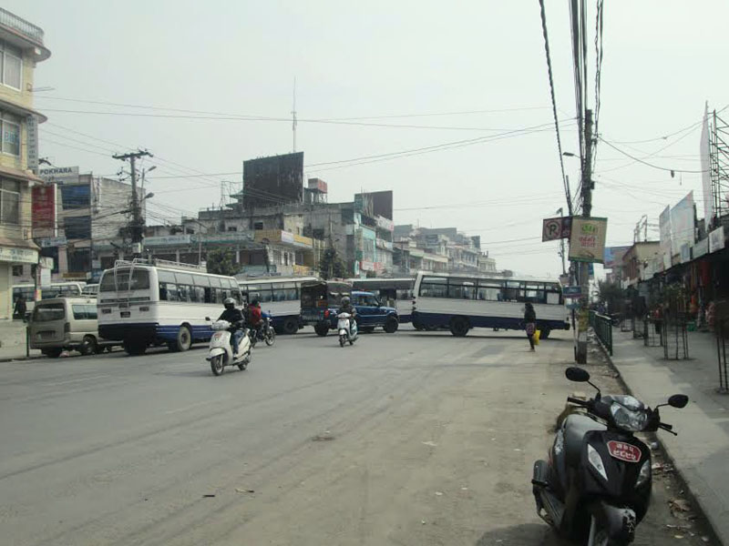 Buses belonging to the Pokhara Bus Entrepreneurs Committee parked haphazardly on the road in Pokhara on Tuesday, February 16, 2016. Photo: Rishi Ram Baral