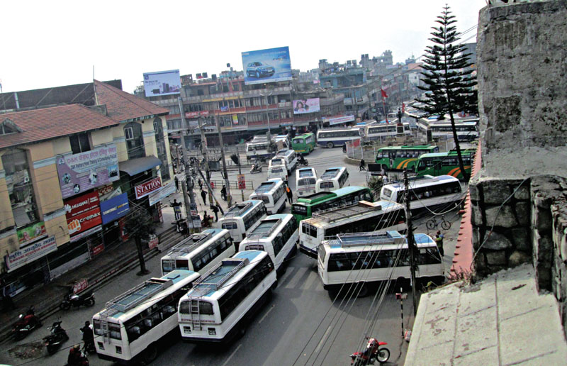 Buses parked on the road obstructing vehicular movement, in Pokhara, on Saturday. Photo: THT