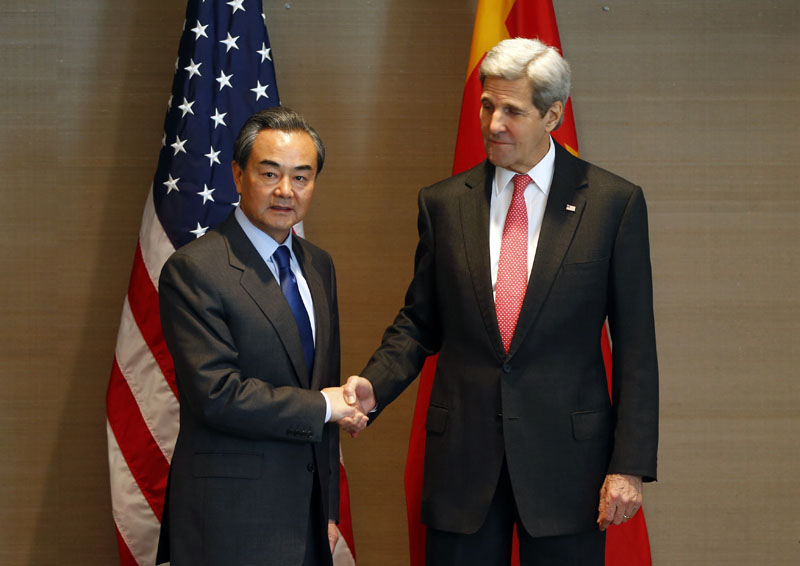 FILE - , file photo, US Secretary of State John Kerry (right) shakes hands with China's  Froreign Minister Wang Yi,  during a meeting in Munich, Germany, before the Munich Security Conference, on February 12, 2016. Photo: AP