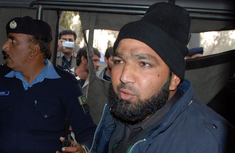 FILE - Commando of Pakistan's Elite force Mumtaz Qadri (right) who killed Punjab's Gov. Salman Taseer, sits in police custody in Islamabad, Pakistan, on January 4, 2011. Photo: AP