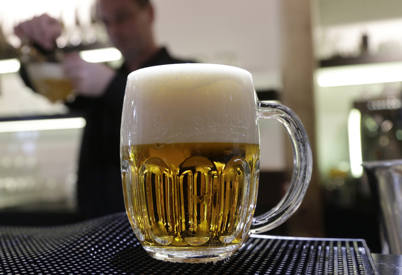 A bartender fills a glass of beer at a pub in Prague, Czech Republic, Tuesday, February 2, 2016. Photo: AP