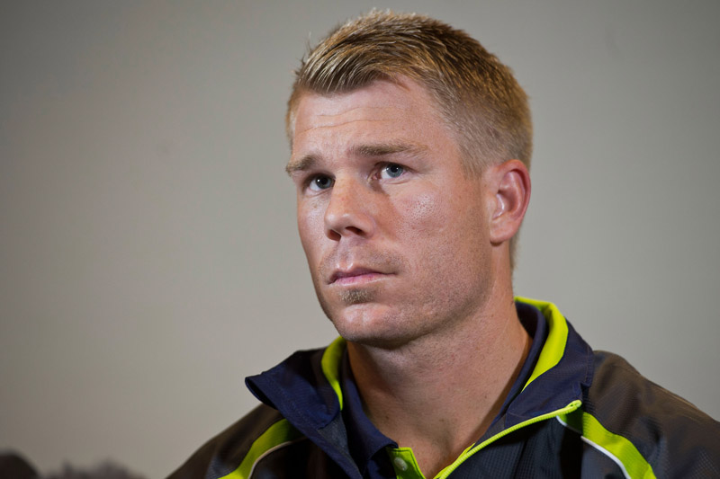 Warner talks to the press at Royal Garden Hotel on June 13, 2013 in London, England.  David Warner and Captain Michael Clarke hold a press conference after David Warner was suspended for an alleged attack on England's Joe Root.  (Photo by Bethany Clarke/Getty Images)