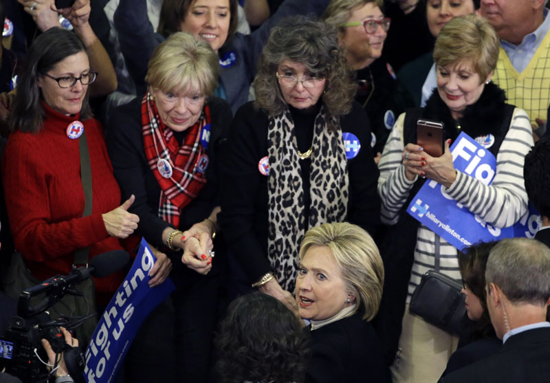 Democratic presidential candidate Hillary Clinton mingles with supporters at her New Hampshire presidential primary campaign rally in Hooksett, New Hampshire on February 9, 2016. Photo: AP