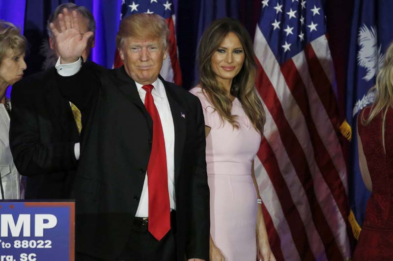 Republican US presidential candidate Donald Trump waves with his wife Melania at his side as he departs after speaking at his 2016 South Carolina presidential primary night victory rally in Spartanburg