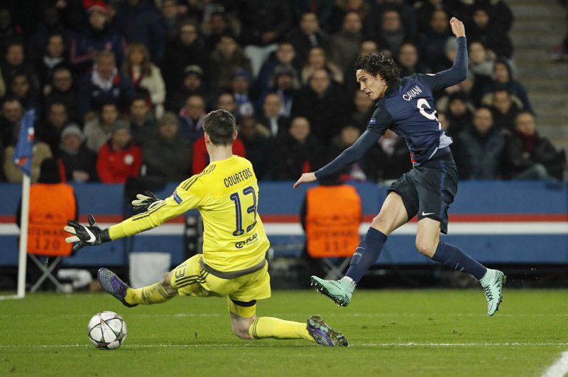 Paris St Germain's Edinson Cavani shoots the ball past Chelsea goalkeeper Thibaut Courtois during their UEFA Champions League match, in Paris, on Tuesday. Photo: Reuters