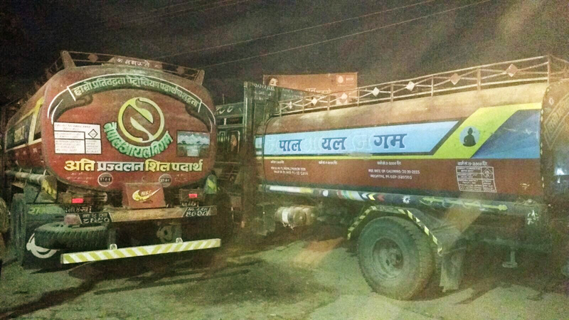 FILE- Nepal Oil Corporation fuel tankers await customs clearance in Raxaul to enter Nepal on Monday, February 08, 2016. Photo: Ram Sarraf