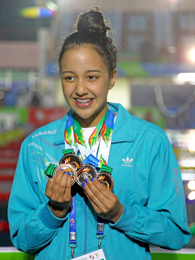 Swimmer Gaurika Singh pose for photo with medals in Sillong, Inda on Wednesday, February 10, 2016. Photo: Mahesh Acharya