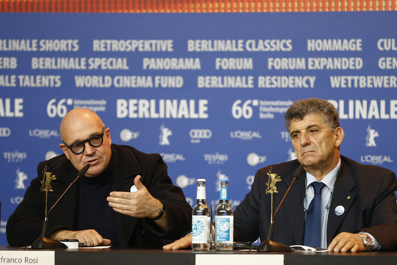 Director Gianfranco Rosi (left) and protagonist Pietro Bartolo attend a press conference for the competition film 'Fire At Sea' at the 2016 Berlinale Film Festival in Berlin, on Saturday, February 13, 2016. Photo: AP