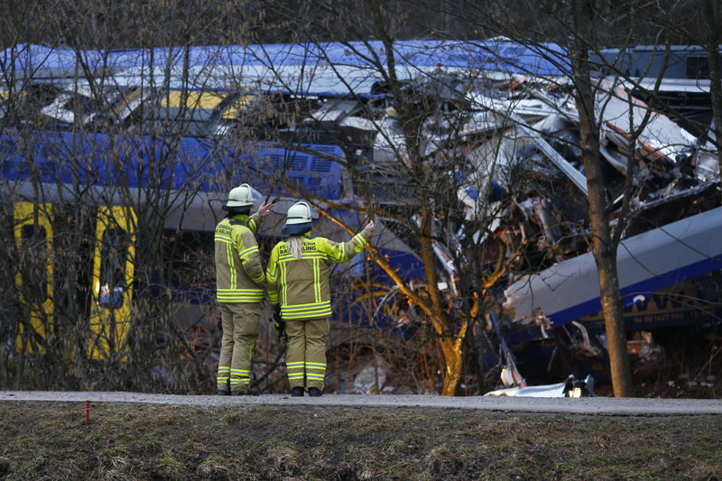 Rescue workers stand in front of two trains that collided head-on near Bad Aibling, Germany,  on Wednesday, February 10, 2016. Photo: AP