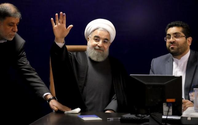 Iranian President Hassan Rouhani (C) waves after he registered for February's election of the Assembly of Experts, the clerical body that chooses the supreme leader, at the Interior Ministry in Tehran December 21, 2015. REUTERS/Raheb Homavandi/TIMA/Files