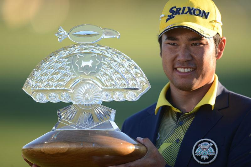 Hideki Matsuyama of Japan holds the trophy after winning the Phoenix Open golf tournament in Scottsdale on Sunday. Photo: THT