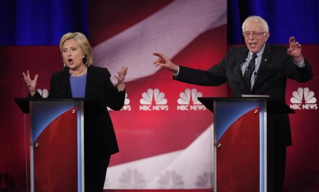 Democratic U.S. presidential candidate and former Secretary of State Hillary Clinton and rival candidate U.S. Senator Bernie Sanders speak simultaneously at the NBC News - YouTube Democratic presidential candidates debate in Charleston, South Carolina January 17, 2016. REUTERS/Randall Hill