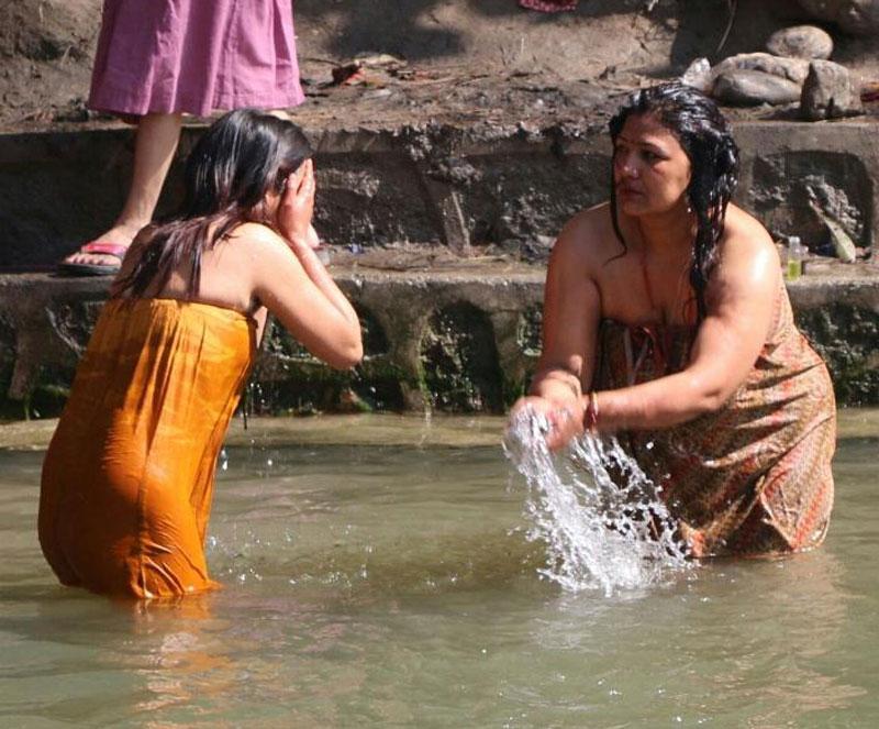 Hindu women taking a holy dip at the Salinadi River in Sankhu, on the outskirts of the Kathmandu, on Monday, February 16, 2016. Courtesy: Achitra Thieng