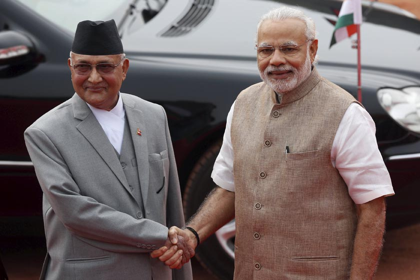Nepal's Prime Minister Khadga Prasad Sharma Oli (L) shakes hands with his Indian counterpart Narendra Modi during his ceremonial reception at the forecourt of India's Rashtrapati Bhavan, the  Presidential Palace, in New Delhi, India, February 20, 2016. REUTERS/Adnan Abidi