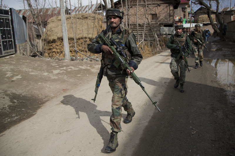 Indian army soldiers patrol near the site of a gunbattle with suspected rebels in Hajin Village some 38 Kilometres (23.75 miles) northeast of Srinagar, Indian controlled Kashmir, on Thursday, February 4, 2016. Photo: AP
